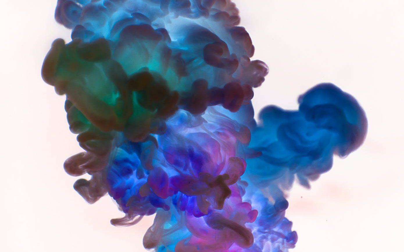 close up photography of blue and green smoke